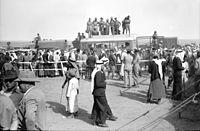 Race meeting. Beersheba. General view of crowds showing Australians on top of busses to see races. 1940 May 4. matpc.20282.jpg