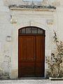 Ribérac 38 pl Ancienne église porte.JPG