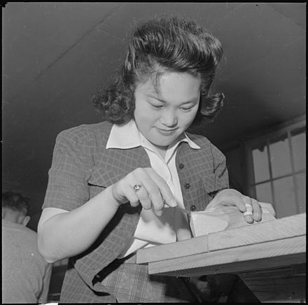 A young woman in the woodworking class Rohwer Relocation Center, McGehee, Arkansas. In the wood carving class, at the Rohwer Center, this . . . - NARA - 539387.jpg