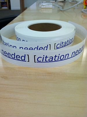 Release liner - Roll of die-cut pressure sensitive labels on a release liner