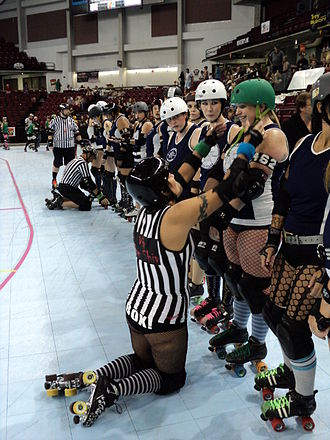 Fishnet - Roller derby athletes at an equipment check wearing three weaves of fishnet stockings ranging from coarse to fine