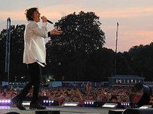 Джаггер выступая с камнями в Гайд-парке в Лондоне в июле 2013 года