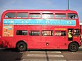 Route 13 Routemaster outside Golders Green tube station side view.jpg