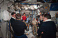STS-135 and Expedition 28 crews after the hatch opening.jpg