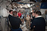 STS-135 and Expedition 28 crews after the hatch opening