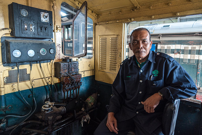 The Chief mechanic of Sabah State Railways operating the HUNSLET diesel engine