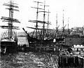 Sailing vessels loading freight at the foot of Madison Street, ca 1895 (SEATTLE 1350).jpg