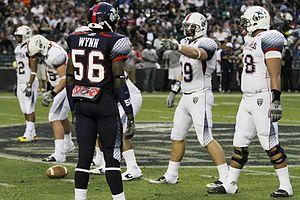 Adam Bisnowaty - Bisnowaty (pointing) during his high school senior year, at the 2012 Semper Fidelis All-American Bowl
