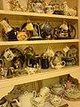 Shelves with several mugs on them.jpg
