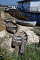 Shoreham-by-Sea Riverside Moorings houseboat and dinghies, West Sussex, England.jpg