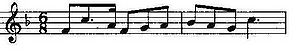Musical notation showing a theme in F and in 6/8 time on a treble clef.