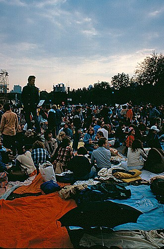 "The Concert in Central Park - The audience waits on the ""Great Lawn"" for the concert's beginning"