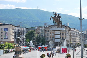Skopje 2014 - Macedonia Square before the commencement of Skopje 2014 (top) and after the addition of many monuments and façade reconstructions (bottom)
