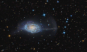 Spiral galaxy with streams of light