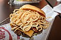 Smashburger BBQ bacon cheddar burger with deep-fried onions.jpg