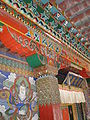Songzalin Monastery main prayer hall entranceway post top.JPG