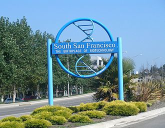 """History of biotechnology - A Genentech-sponsored sign declaring South San Francisco to be """"The Birthplace of Biotechnology."""""""