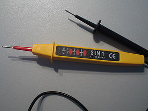 Test light -  A voltage tester with three lamps to give an approximate indication of voltage magnitude