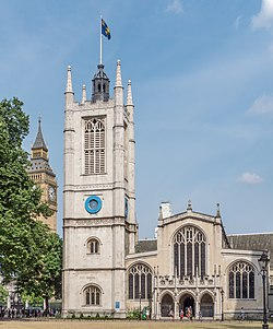 St Margaret's Church, Westminster, with the Elizabeth Tower of the Palace of Westminster in the background (Big Ben).