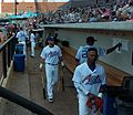 St. Paul Saints players wearing Mr. Paul Aints jerseys in dugout at CHS Field.jpeg