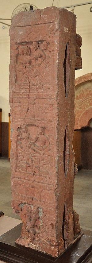 Rishyasringa - Story of Rishi Sringa Reverse Shows Woman Carrying Wine Pot and Holding Bunch of Grapes - Circa 2nd Century CE - Bhuteshwar Mathura Museum.