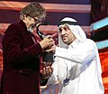 Suhail Galadari hands over the Best Actor Male award to Amitabh Bachchan.jpg