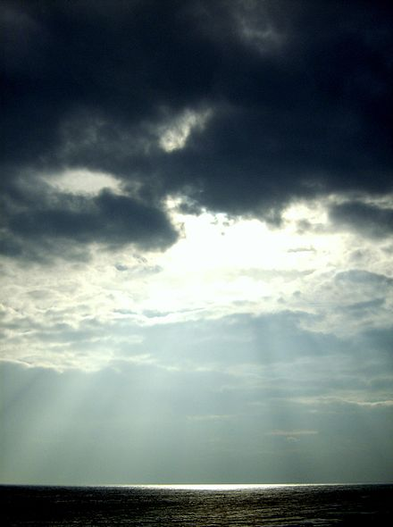 Sunlight shining through clouds, giving rise to crepuscular rays Sunshine at Dunstanburgh.JPG