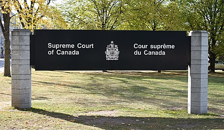 Signage for the supreme court in French and English. Either language may be used in federal courts. Supreme Court of Canada sign.jpg