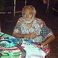 Suriname 035 Erwin en zijn beschilderde tafel.JPG