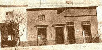 Patriotic Leagues (Southern Cone) - Chilenization of Tacna. Peruvian household harassed by being marked with a black cross. In the background a Chilean flag.