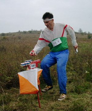 "Control point (orienteering) - An orienteer about to ""punch"" at a control"