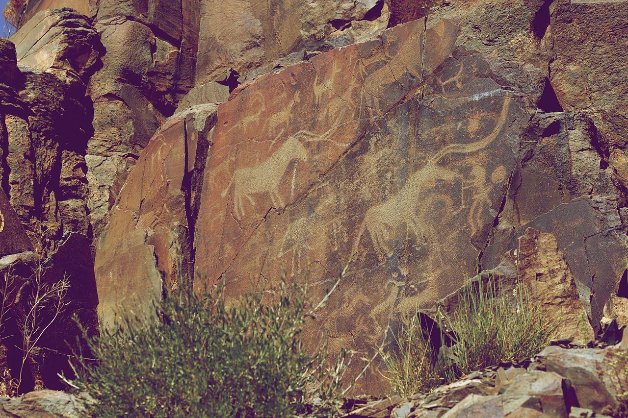 Tamgaly Petroglyphs Bull and Humans.jpg