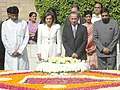 Tassos Papadopoulos and his wife Mrs. Fotini Papadopoulos paying homage at the Samadhi of Mahatma Gandhi in Delhi on April 12, 2006. The Minister of State for External Affairs, Shri Anand Sharma is also seen.jpg