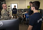 Tech. Sgt. Sean Cantrell explains the dispatch room's purpose.jpg