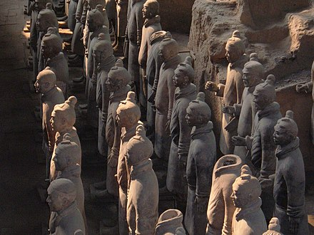 The Terracotta Army (c. 210 BCE) discovered outside the Mausoleum of the First Qin Emperor, now Xi'an Terracotta Army Pit 1 front rank detail.JPG