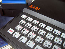 "View of the left-hand side of the ZX81's keyboard, showing about half of the keys and the red ""ZX81"" logo on the case"