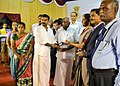 The Minister of State for Commerce & Industry (Independent Charge), Smt. Nirmala Sitharaman presenting the POS machine to a lucky winner at the DigiDhan Mela programme, in Madurai, Tamil Nadu.jpg