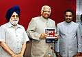The Speaker, Lok Sabha Shri Somnath Chatterjee releasing a book, 'Office of Profit', in New Delhi on May 22, 2006. The Secretary General, Lok Sabha and author of 'Office of Profit' Shri P.D.T. Achary is also seen.jpg
