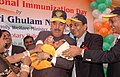 The Union Minister for Health and Family Welfare, Shri Ghulam Nabi Azad administering the polio drops to a child at the launch of the National Immunization Day for polio, in New Delhi on February 07, 2010.jpg