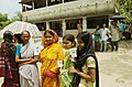 The women voters showing their Election Commission's Photo Identity card to cast their vote, at Jagaddal Vidhan Sabha, North 24 pargana in West Bengal on April 27, 2006.jpg