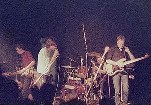 The Fall (band) - The Fall Perverted by Language Tour, Hamburg (Markthalle), 13.April 1984. L-R: Craig Scanlon, Mark E. Smith, Karl Burns, Steve Hanley