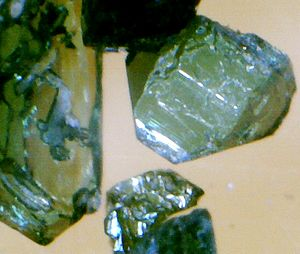 Thorite - Small crystals of green thorite under magnification
