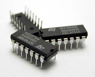 Dual in-line package - Three 14-pin plastic dual in-line packages (DIP14) containing IC chips