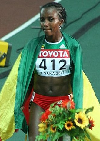 Tirunesh Dibaba - Dibaba celebrating her 10,000 metres victory at the 2007 World Championships.