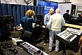 Tom Oberheim back shot with Two Voice Pro & SEM, TomOberheim.com booth - 2015 NAMM Show.jpg
