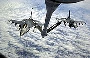 Two F-16s from Aviano Air Base, Italy, drop away from the boom after gassing up from a KC-135 Stratotanker