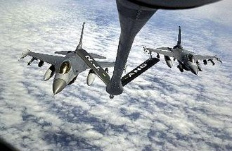 16th Air Expeditionary Wing - Two F-16s from Aviano Air Base, Italy, after fueling from a KC-135 Stratotanker over the Adriatic Sea