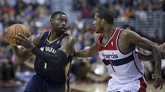 Tyreke Evans - Evans with the Pelicans in February 2014, being defended by Trevor Ariza.