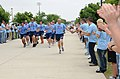 U.S. Air Force Brig. Gen. Andrew Mueller carries the torch past a cordon of Airmen prior to the start of the Mississippi Special Olympics Summer Games at Keesler Air Force Base, Miss., May 13, 2011 110513-F-BD983-004.jpg
