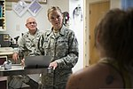 U.S. Air Force Senior Airman Megan Stanton, center, a medic with the 366th Medical Operations Squadron (MDOS), listens to a patient explain her condition while Maj. David Strickland, left, a physician also with 130716-F-NW635-031.jpg